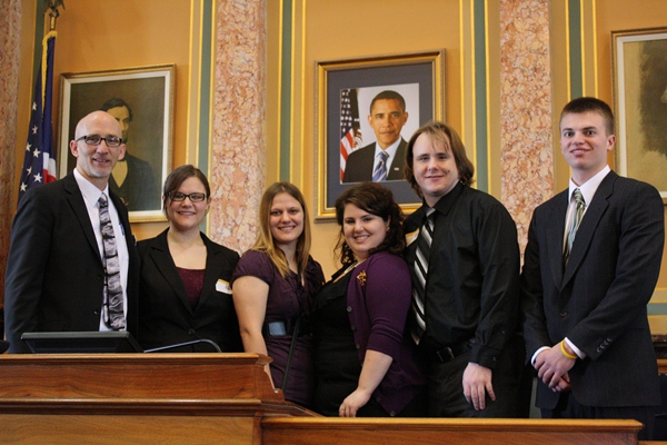 Representative Walt Rogers (R) of Cedar Falls hosts UNI student athletes at the Statehouse.